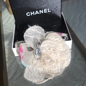 Chanel silk flower brooch.